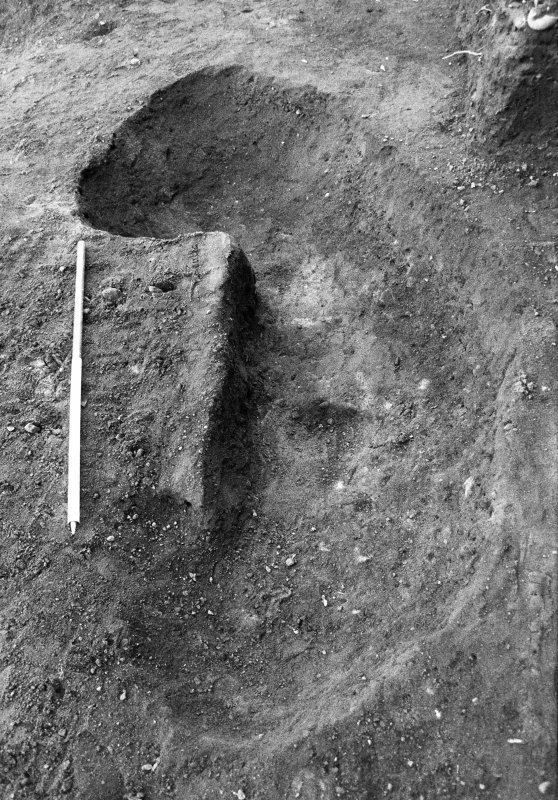 Excavation photograph : feature f702 almost completely excavated, from S.