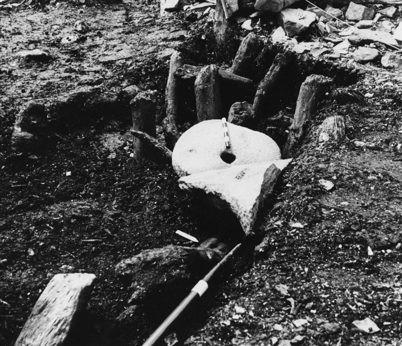 Excavation photograph : rotary quern in situ.