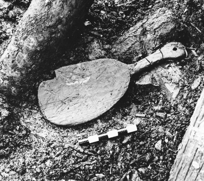 Excavation photograph : wooden paddle.  (large mounted copy print stored with MS/456)