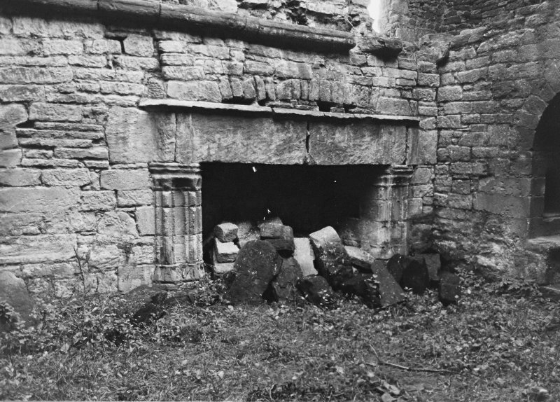 Excavation archive: Fireplace in E wall of hall at first floor level. prior to rubble clearance. From W.
