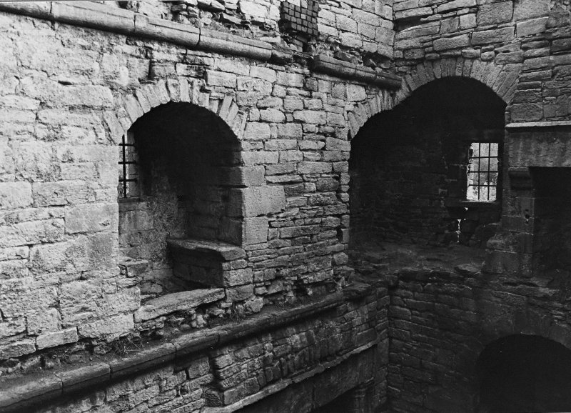 Excavation archive: Interior of tower at second floor level, showing remains of mural chamber in SE corner and window embrasure in E wall. From NW.