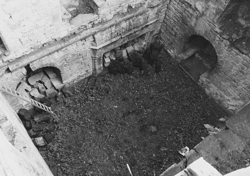 Excavation archive:Interior of tower prior to clearance of debris from first floor hall. From NW.