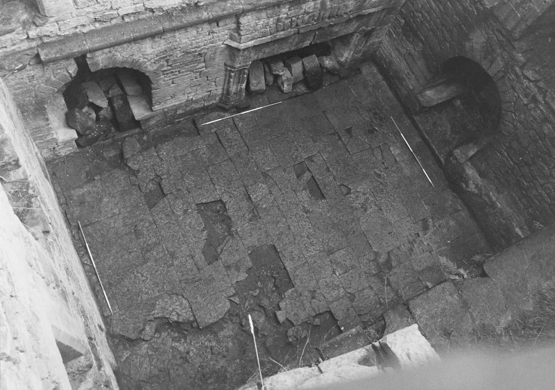 Excavation archive: First floor hall, viewed from above, after clearance of debris. From NW.