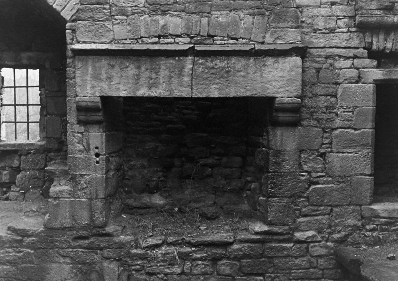 Excavation archive: Fireplace in S wall of tower at second floor level. From N.