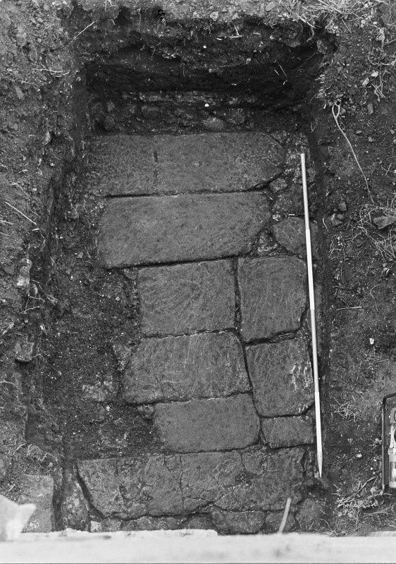 Excavation archive: Close-up of flagged surface outside entrace. From E.