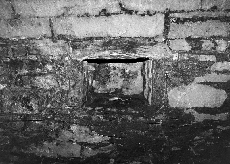 Excavation archive: Niche in E wall of kitchen. From W.