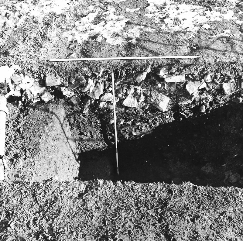 Roberton, motte: excavation photograph of ditch (S side of storm drain) from W C Tabraham, 1979