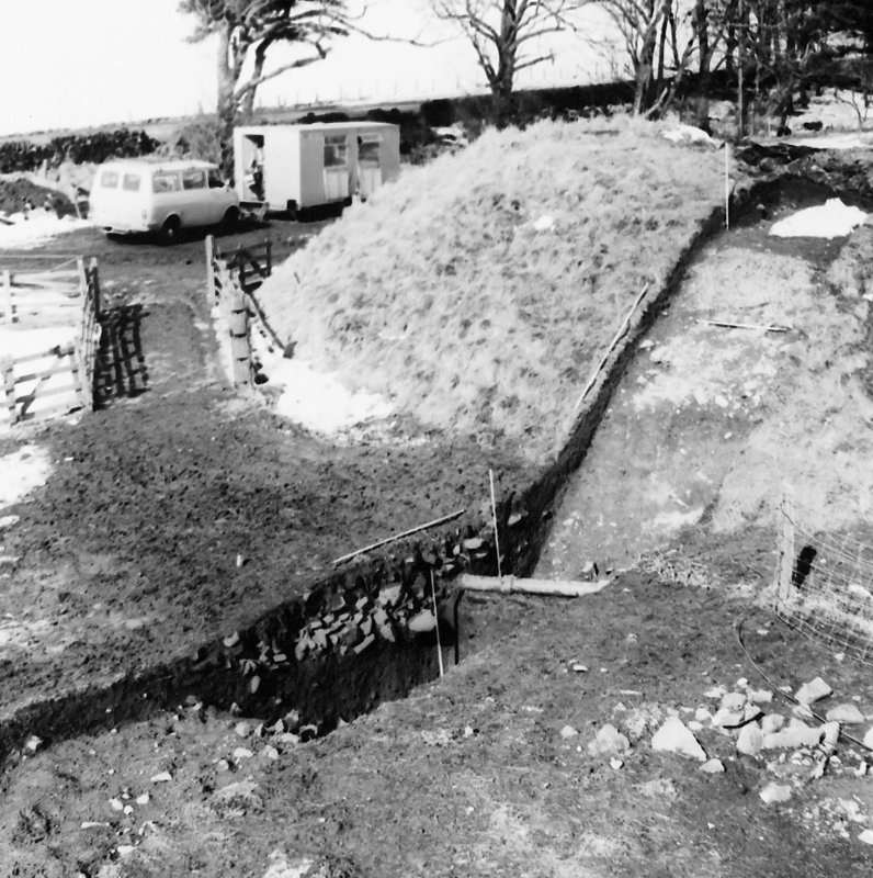Roberton, motte: excavation photograph of fully excavated ditch from SE C Tabraham, 1979