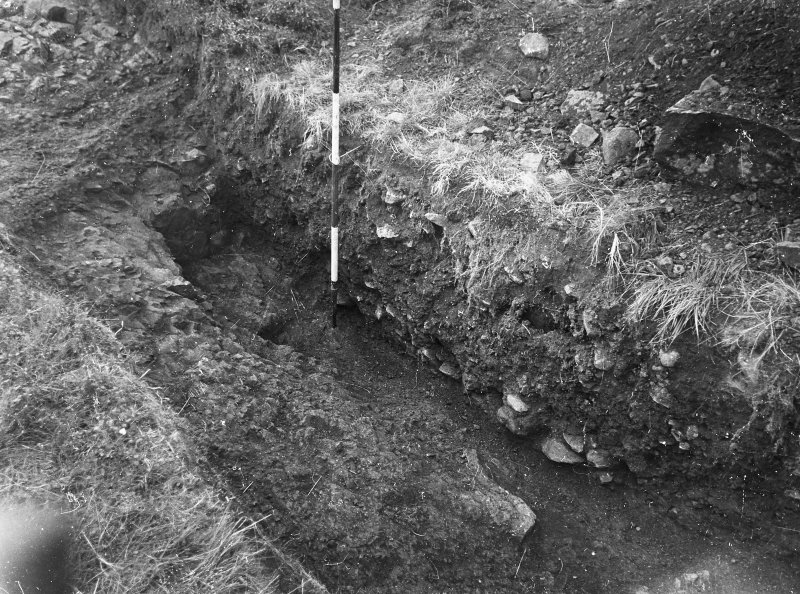 Cairnpapple Hill,  photograph of excavation showing henge ditch on W side.