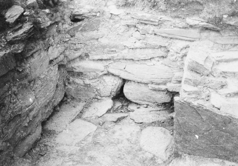 Photograph taken during excavation. Walling immediately N of altar, from W.