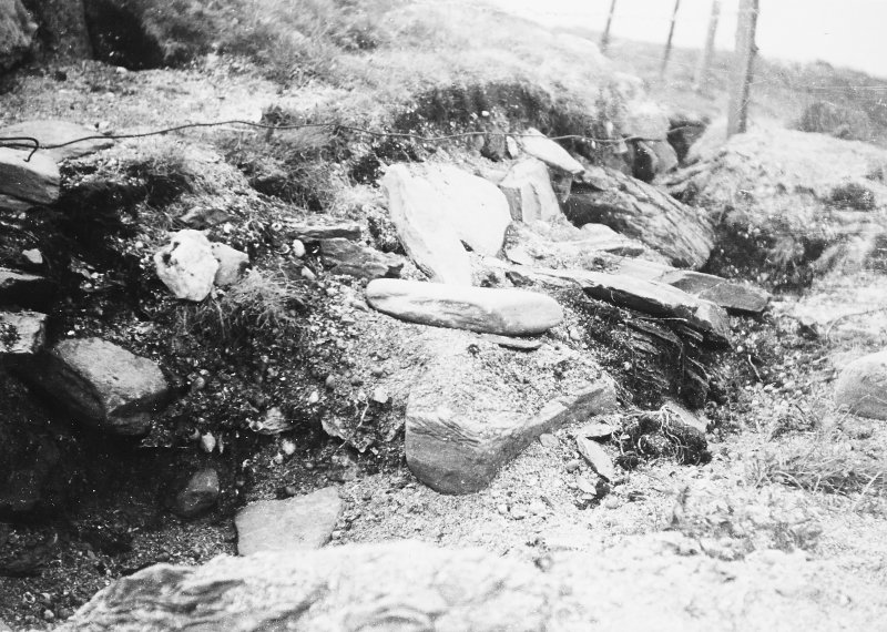 photograph taking during excavation, probably of boundary wall.