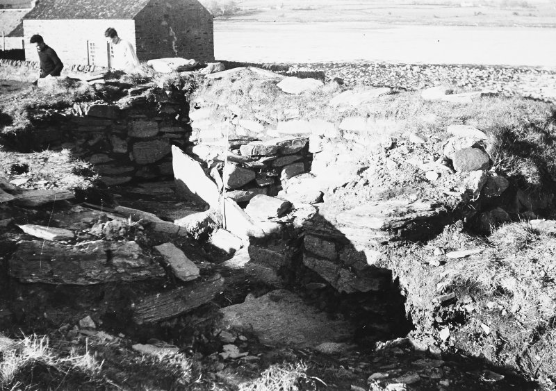 Photograph taken during excavation. Altar, doorway, exterior and interior from SW.