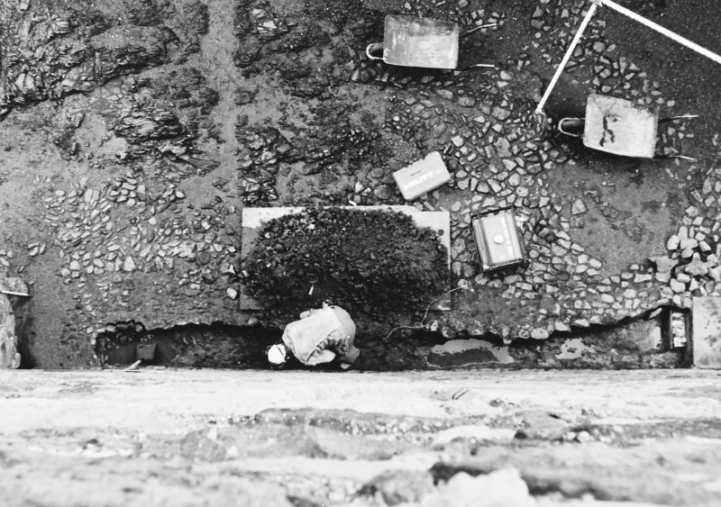 Excavation photograph : trench 1, showing bedrock being removed, from above.