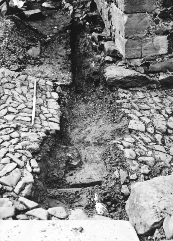 Excavation photograph : trench 2 showing boulders and clay, from N.