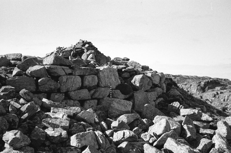 Dun Mor, Vaul, Tiree, broch. Photograph showing the outer wallface on the seaward side, prior to excavation.