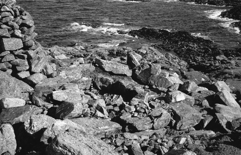 Dun Mor, Vaul, Tiree, broch. Photograph showing the entrance passage filled with rubble and the filled guard cell, prior to excavation.