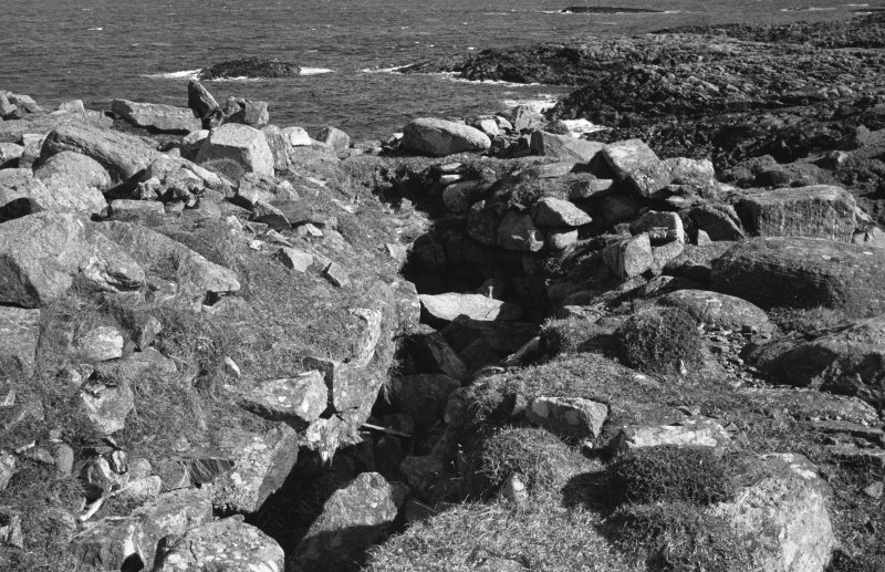 Dun Mor, Vaul, Tiree, broch. Photograph showing the mural gallery with one lintel in situ, prior to excavation.