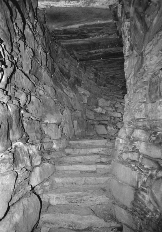 Stairway and walls of landing beyond.