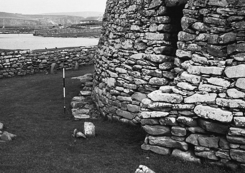 Outer wall of broch with 'spur' and foundations beyond