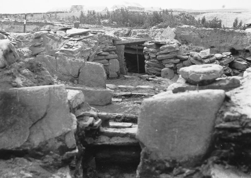 Excavation Photograph: Hut 8, door thro' gap in N walls. pl.xvii.1.