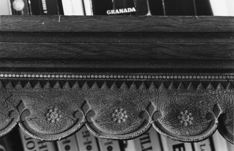 Interior. Detail of carving on bookcase.