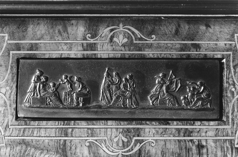 Interior. Detail of carving and inlay on bookcase.