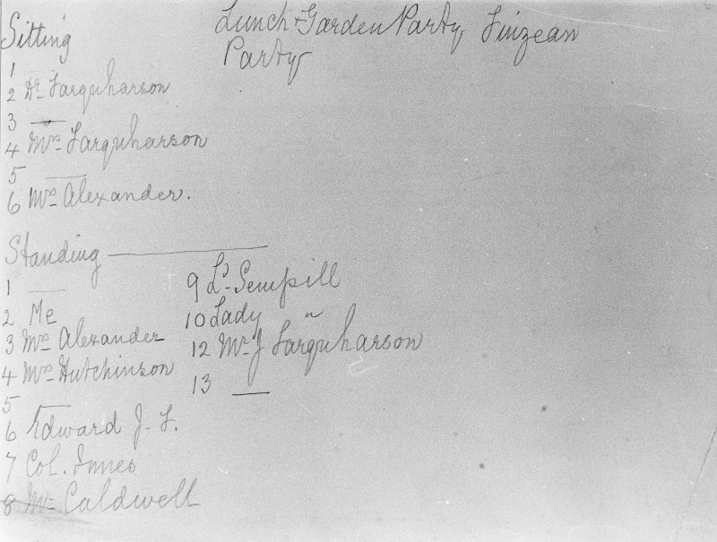 Copy of historic photograph listing group of people attending lunch party.