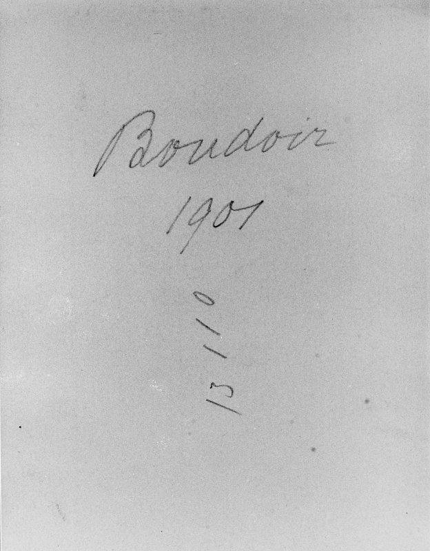 Notes on reverse of photograph showing interior view of boudoir.