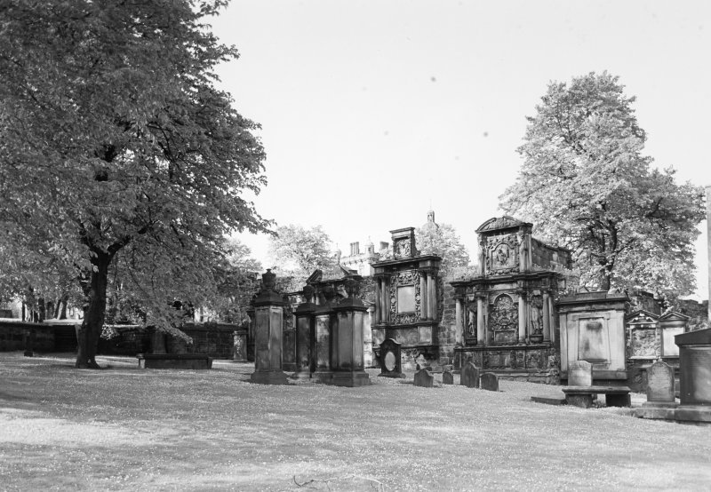 General view of monuments in churchyard.