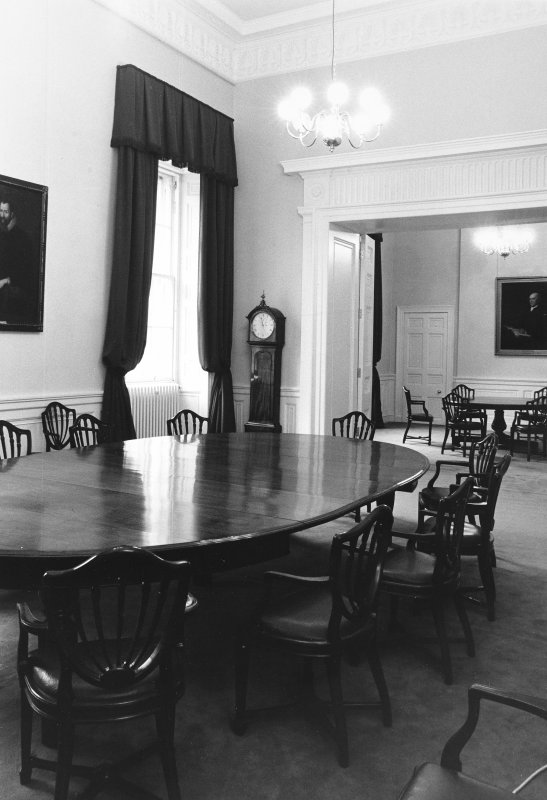 Interior-view of Elder and Lee Rooms, with clock standing to right of window and two large tables with chairs