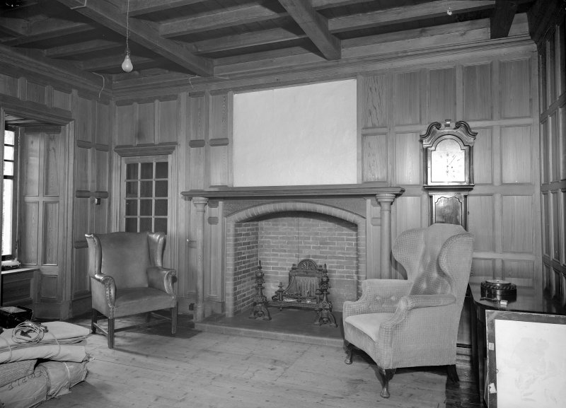 Interior view of Fiddes Castle showing panelled sitting room.