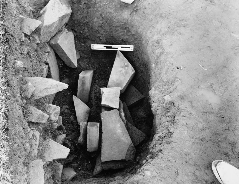 Excavation photograph - West stone hole (showing packing) from N.N.W.