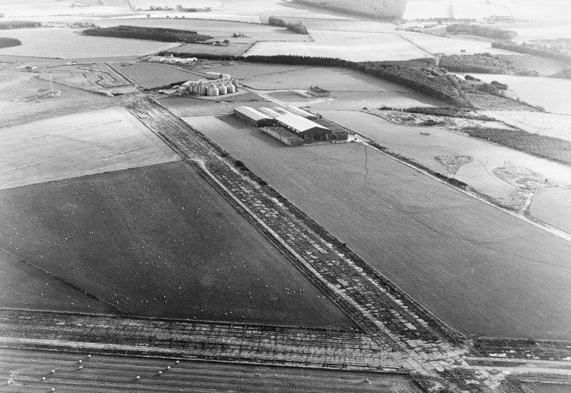 Oblique aerial view of Banff Airfield, taken from the south east, centred on the airfield.
