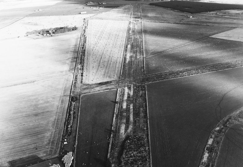 Oblique aerial view of Banff Airfield, taken from the north west, centred on the airfield.