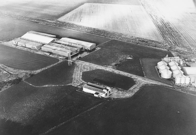 Oblique aerial view of Banff Airfield, taken from the south west, centred on the airfield.
