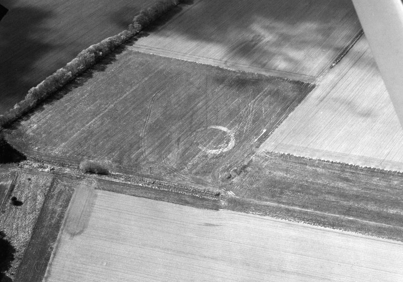 Oblique aerial view of Middleton centred on the cropmarks of an enclosure, taken from the SE.