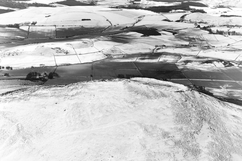 Tap o'Noth, vitrified fort: aerial view under snow.