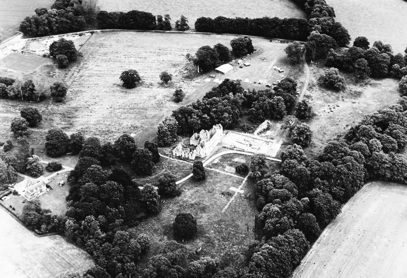Oblique aerial view of Fetternear House centred on the remains of a tower house, taken from the W.