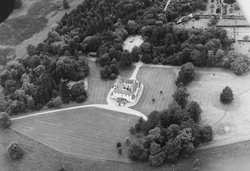 Oblique aerial view of Leith Hall centred on the country house with walled garden adjacent, taken from the E.