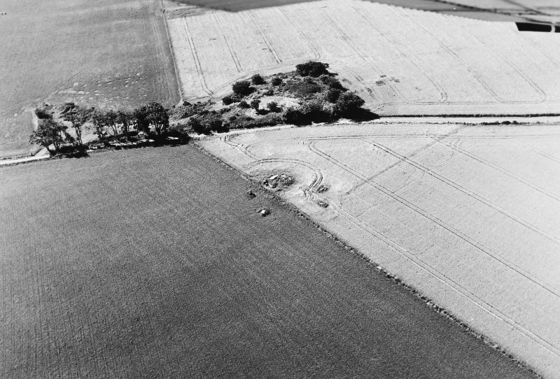 Oblique aerial view of Old Rayne centred on the remains of a recumbent stone circle, taken from the NE.