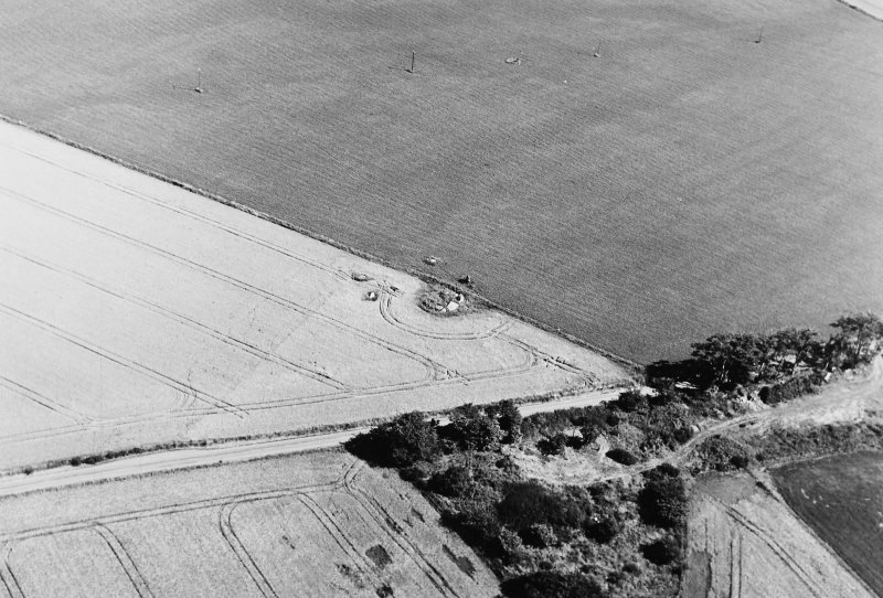 Oblique aerial view of Old Rayne centred on the remains of a recumbent stone circle, taken from the SW.