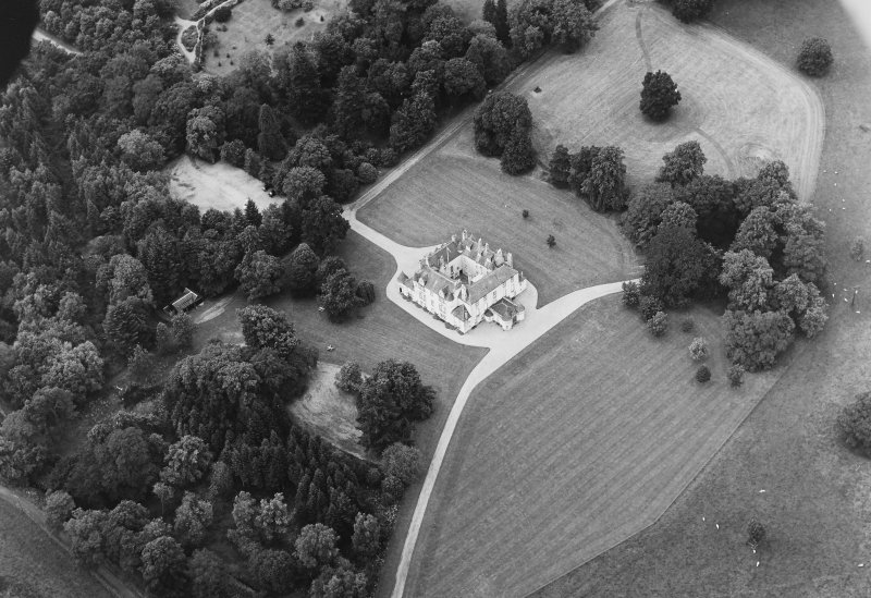 Oblique aerial view of Leith Hall centred on the country house with walled garden adjacent, taken from the SE.