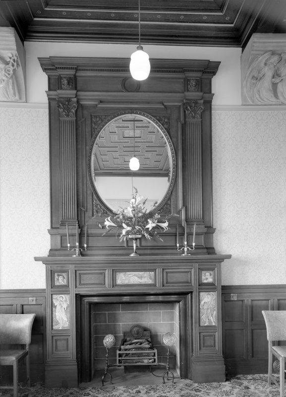 Interior view of Cairndhu Hotel, Ardrossan, showing  dining room fireplace.
