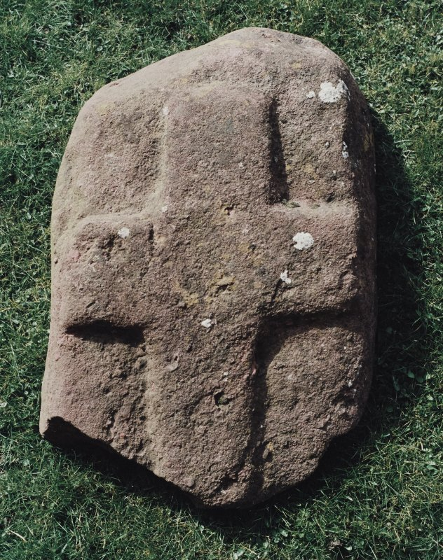 View of small slab, bearing cross carved in low relief.