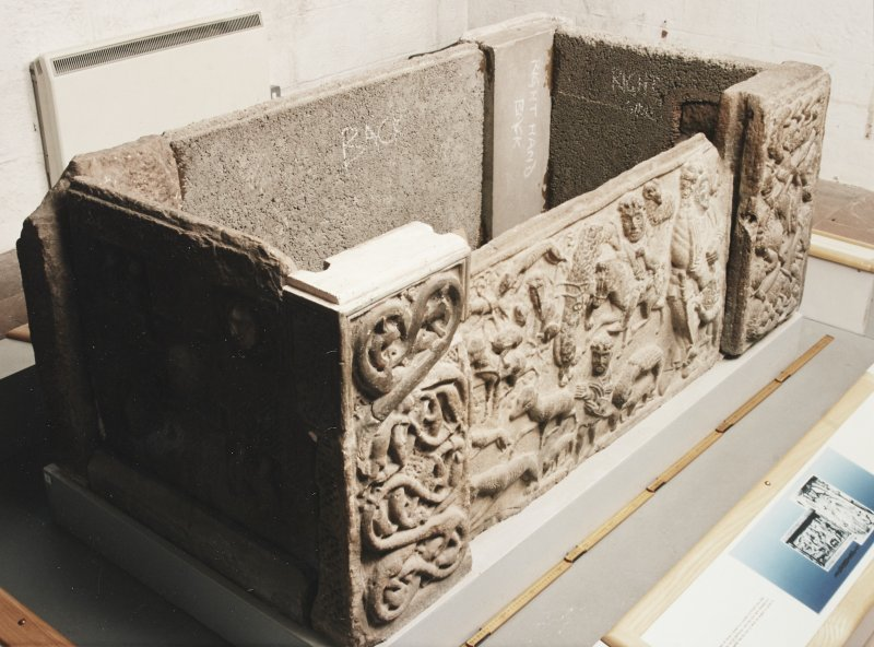 Three-quarter view of sarcophagus, from the left and above. (Panels 1, 1A, corner posts 1B, 1C)