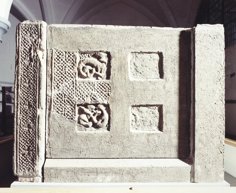 View of right end panel and corner post of sarcophagus. (Corner-posts 1B and 1E)