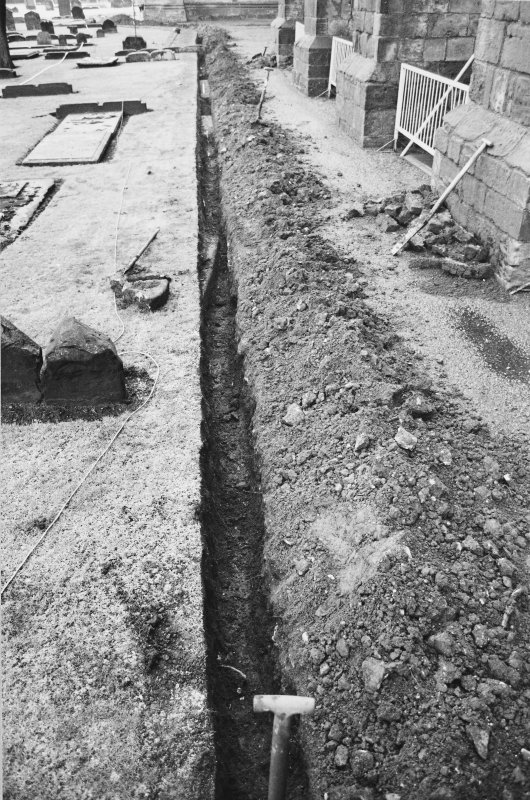Excavation photograph - View along Trench 1 showing locations of grave markers Iq, Ir and Is