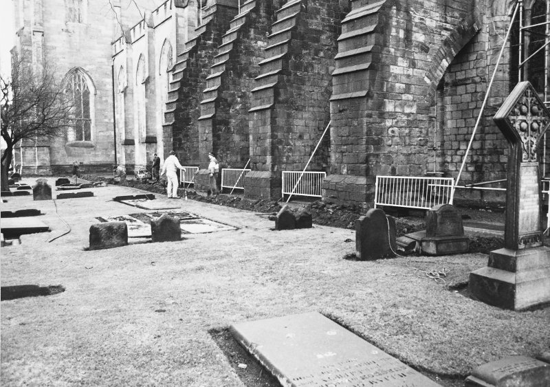 Excavation photograph - General view of excavation under way to the N of the church