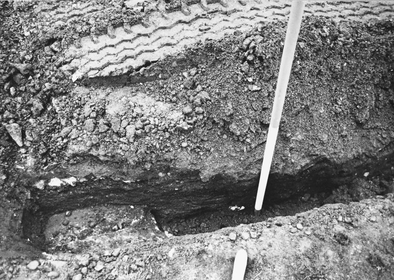 Excavation photograph - Section of cable track including tilting slabs (It) and the SE corner of recumbent slab (Iu) - from N