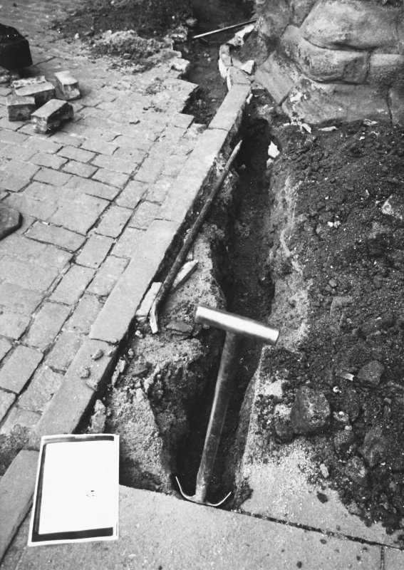 Excavation photograph - Excavation along N side of Monastery Street, in front of refectory - from E